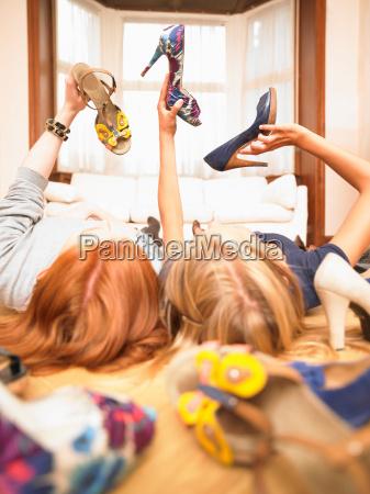 young women choosing shoes