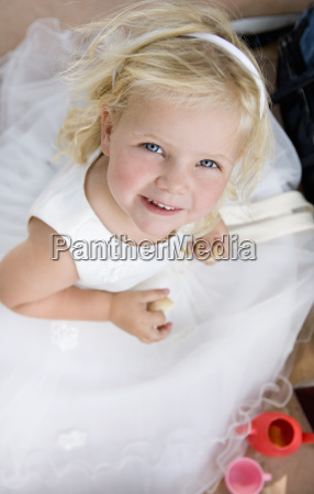 young girl in white dress portrait