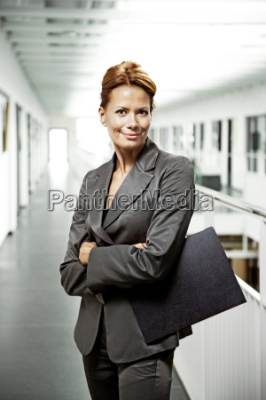 business, woman, holding, a, file, , smiling - 18420268