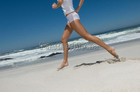female running on beach