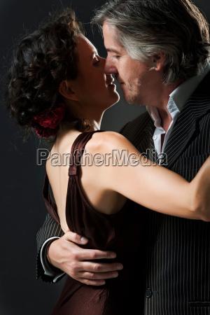 man woman dancing tango