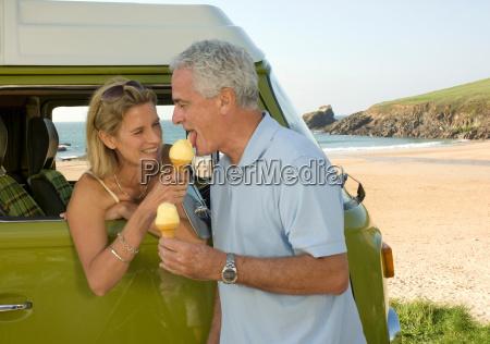 mature couple eating ice cream