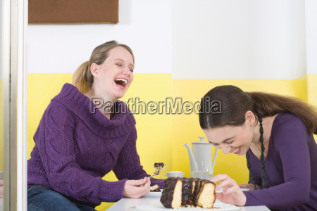 two young women on table
