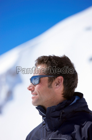 man wearing sunglasses on mountain