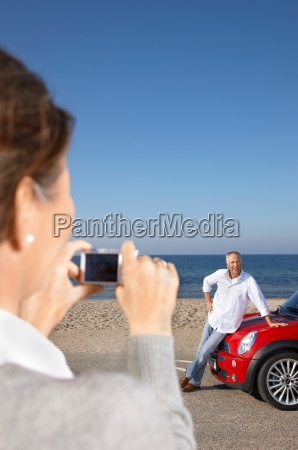 woman taking photo of man by