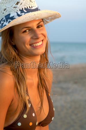 young woman wearing a cap