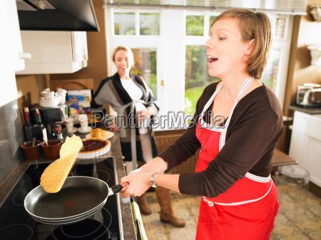 pregnant women making pancakes