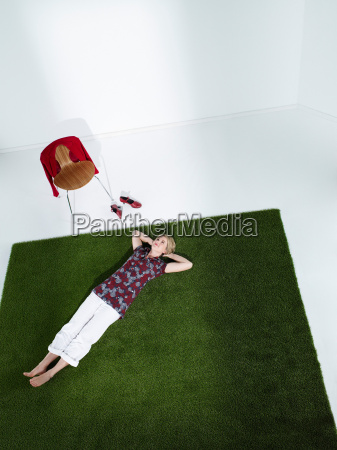 woman laying down on grass