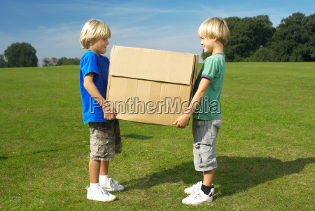 two boys holding box