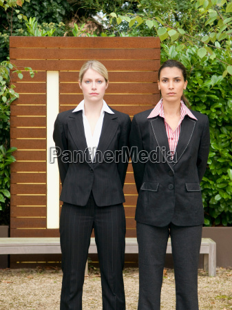 a portrait of two business woman