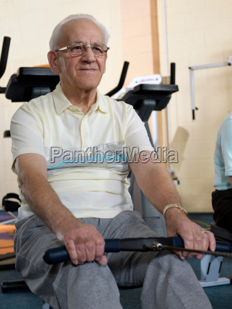 senior male training at gym