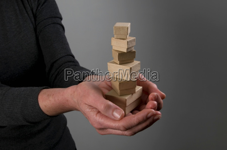 female hands holding small boxes