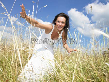 woman in a field looking