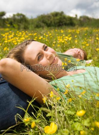 couple lying in meadow