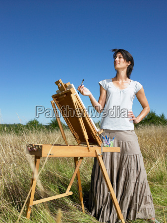 woman painting in a field
