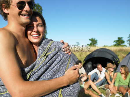 couple wrapped in a cover at