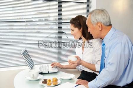 woman and senior man looking at