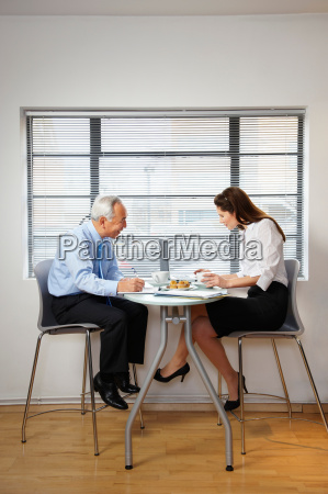 co workers at cafe table with
