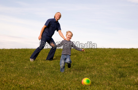 boy and father play ball