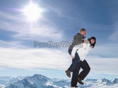 hikers playing piggyback ride