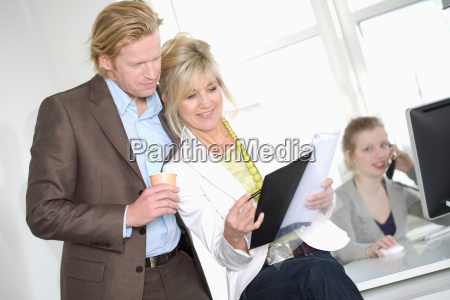 businessman and laughing woman standing
