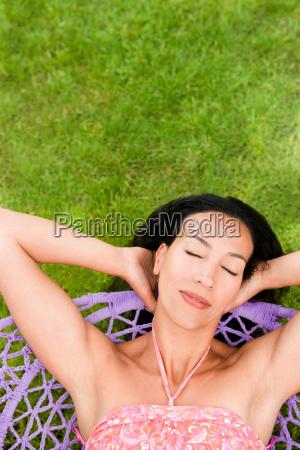 woman relaxing in a swing eyes