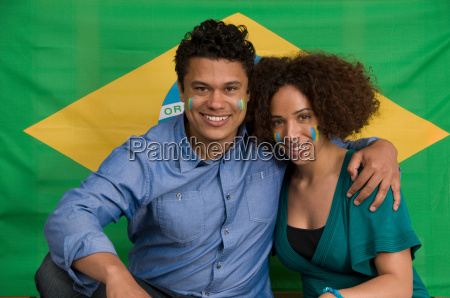 couple smiling with brazilian flag