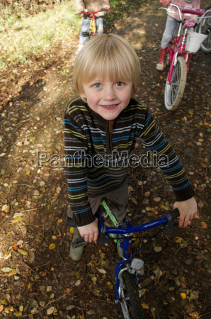 young boy on bike on country