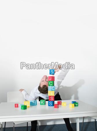business man bends over backwards