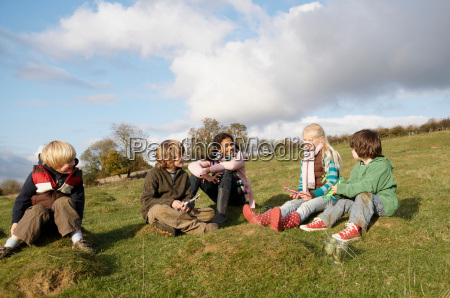 group of children sitting on hill