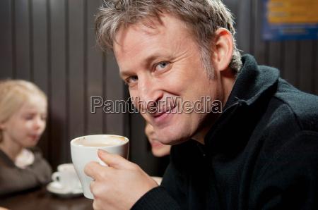 portrait of man with chocolate mug
