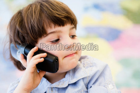 young boy phoning
