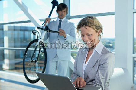 business man and woman with computer