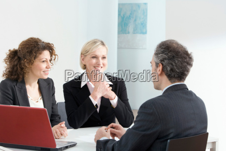 a business meeting with a red