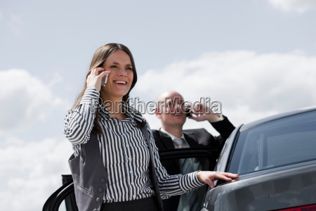 man and woman near car on