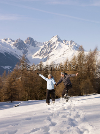 couple jumping in the snow