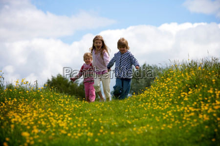 3 young children running