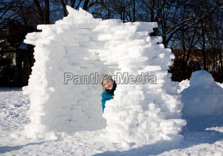 girl in igloo in the snow