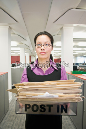 business woman holding a post in