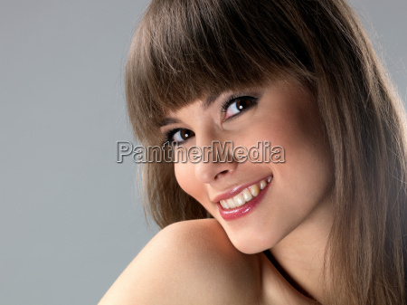 young woman laughing close up