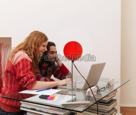 couple on laptop using credit card