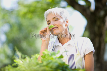 woman taking a smell at some