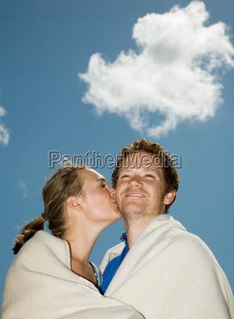couple in blanket kissing