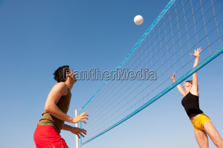 couple playing beach volleyball