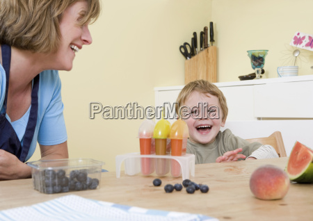 boy and mum laughing