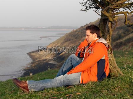 man looking across sea