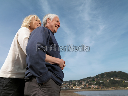 mature couple hugging on beach
