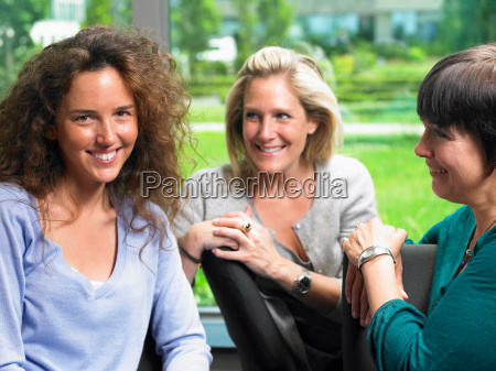 women looking at camera smiling