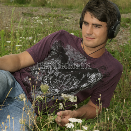 young man with headphones in park