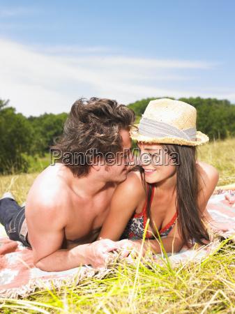 couple on blanket in field